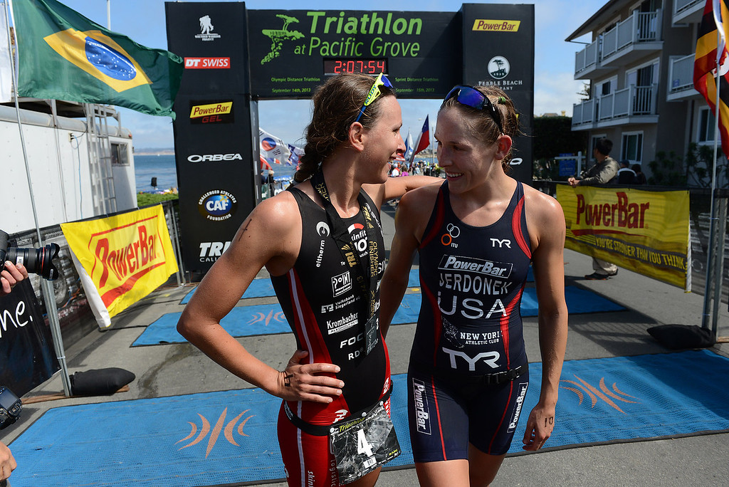 . Womens winner Radka Vodickova of Czechoslovakia, left, and runner up Lindsey Jerdonek of Ohio greet each other after the Elite Race at the Pacific Grove Triathlon in Pacific Grove, Calif. on Saturday September 14, 2013.  Photo David Royal/ Monterey County Herald)