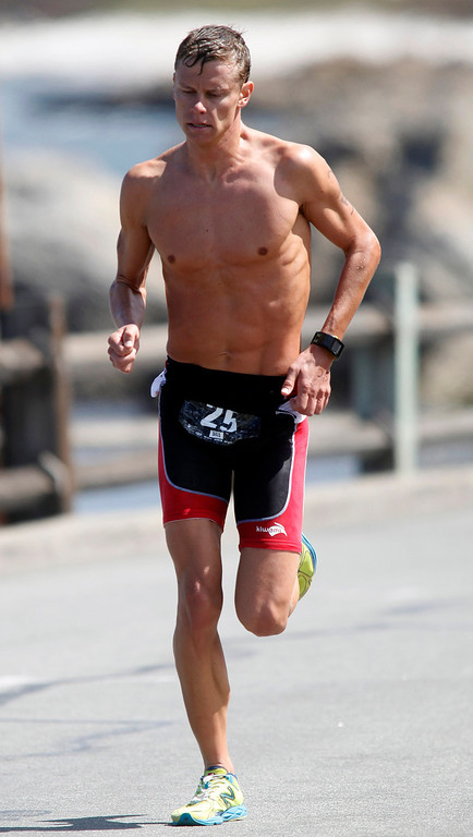 . Mens second place finisher Chris Braden hammers out the final yards to the finish during the Elite Race at the Pacific Grove Triathlon in Pacific Grove, Calif. on Saturday September 14, 2013.  Photo David Royal/ Monterey County Herald)