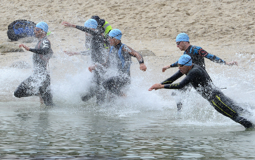 . Men start the swim leg at Lovers Point Beach during the Elite Race at the Pacific Grove Triathlon in Pacific Grove on Saturday September 14, 2013.  Photo David Royal/ Monterey County Herald)