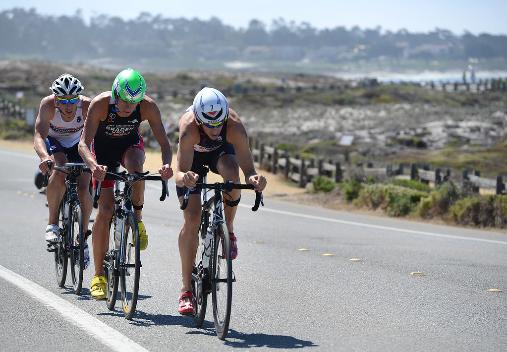 . Mens winner Tommy Zaferes of Aptos, Calif. leads Chris Braden of Boulder and Dustin McLarty of Irvine on the bicycle leg during the Elite Race at the Pacific Grove Triathlon in Pacific Grove, Calif. on Saturday September 14, 2013.  Photo David Royal/ Monterey County Herald)