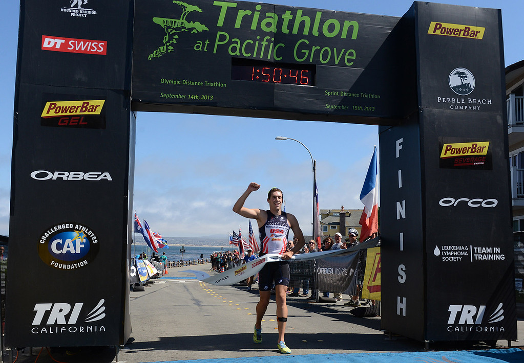 . Mens winner Tommy Zaferes of Aptos, Calif. crosses the finish line during the Elite Race at the Pacific Grove Triathlon in Pacific Grove, Calif. on Saturday September 14, 2013.  Photo David Royal/ Monterey County Herald)