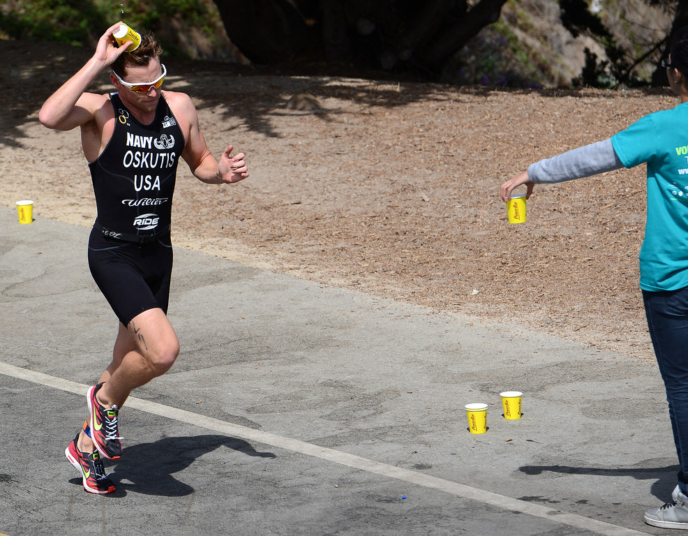 . Derek Oskutis dumps water on his head during the Elite Race at the Pacific Grove Triathlon in Pacific Grove, Calif. on Saturday September 14, 2013.  Photo David Royal/ Monterey County Herald)