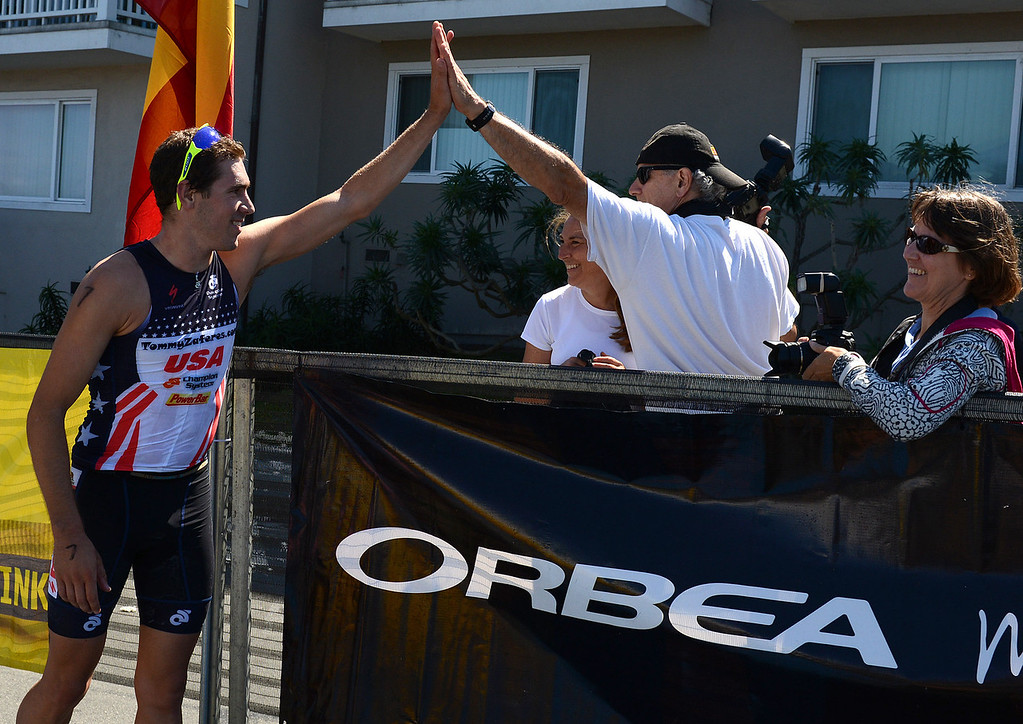 . Mens winner Tommy Zaferes of Aptos, Calif. greets his father George after winning the Elite Race at the Pacific Grove Triathlon in Pacific Grove, Calif. on Saturday September 14, 2013.  Photo David Royal/ Monterey County Herald)