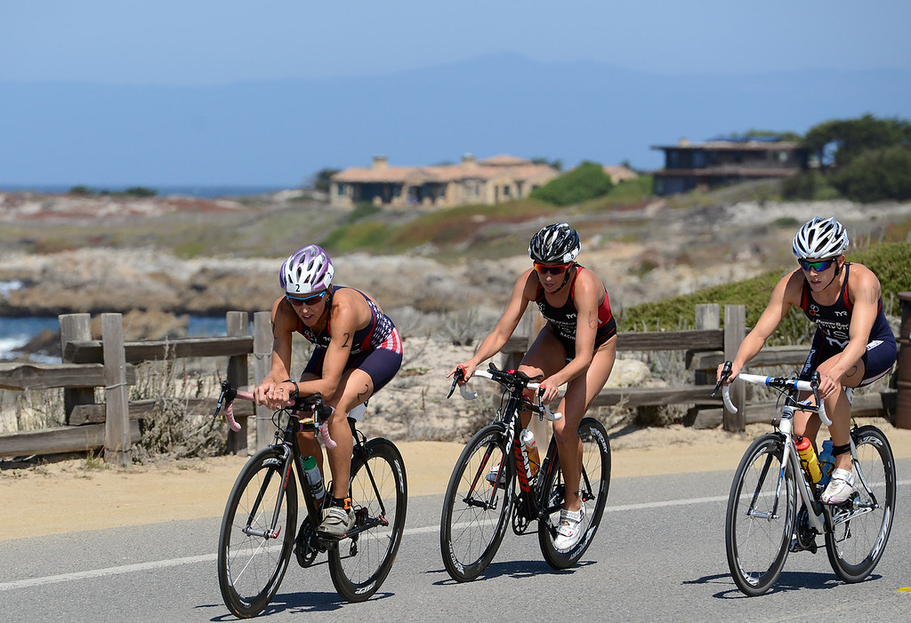 . Julie Ertel, Kelsey Withrow and Lindsey Jerdonek race toward Asilomar Beach during the Elite Race at the Pacific Grove Triathlon in Pacific Grove, Calif. on Saturday September 14, 2013.  Photo David Royal/ Monterey County Herald)