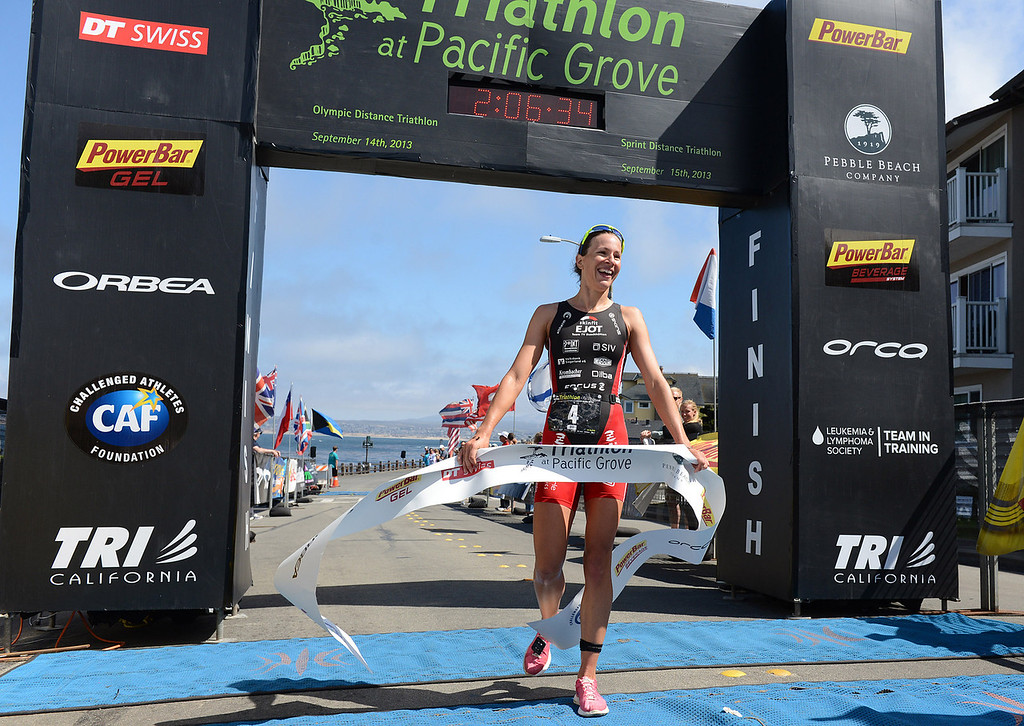 . Womens winner Radka Vodickova of Czechoslovakia crosses the finish line during the Elite Race at the Pacific Grove Triathlon in Pacific Grove, Calif. on Saturday September 14, 2013.  Photo David Royal/ Monterey County Herald)