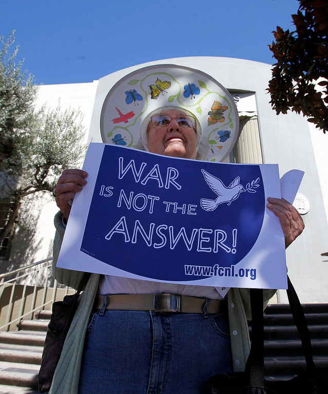 . Joyce Vandevere from Monterey participates with the Peace Coalition of Monterey County in a demonstration in Salinas on September 4, 2013 against possible US military action in Syria.  (Vern Fisher/Monterey County Herald)