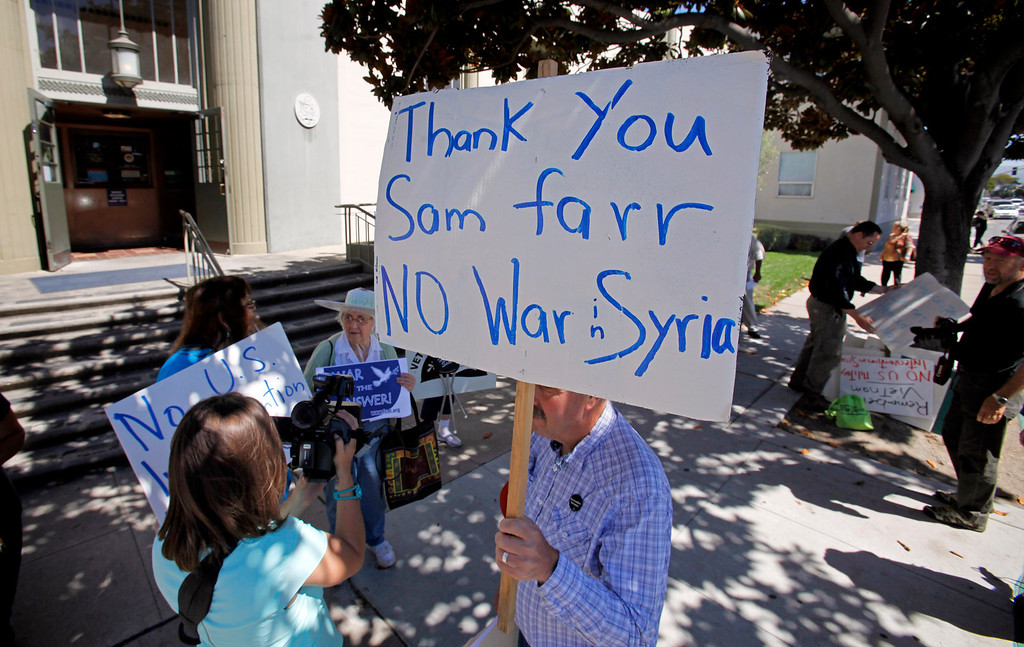 . Gary Karnes (holding sign) with the Peace Coalition of Monterey County in a demonstration in Salinas on September 4, 2013 against possible US military action in Syria.  (Vern Fisher/Monterey County Herald)