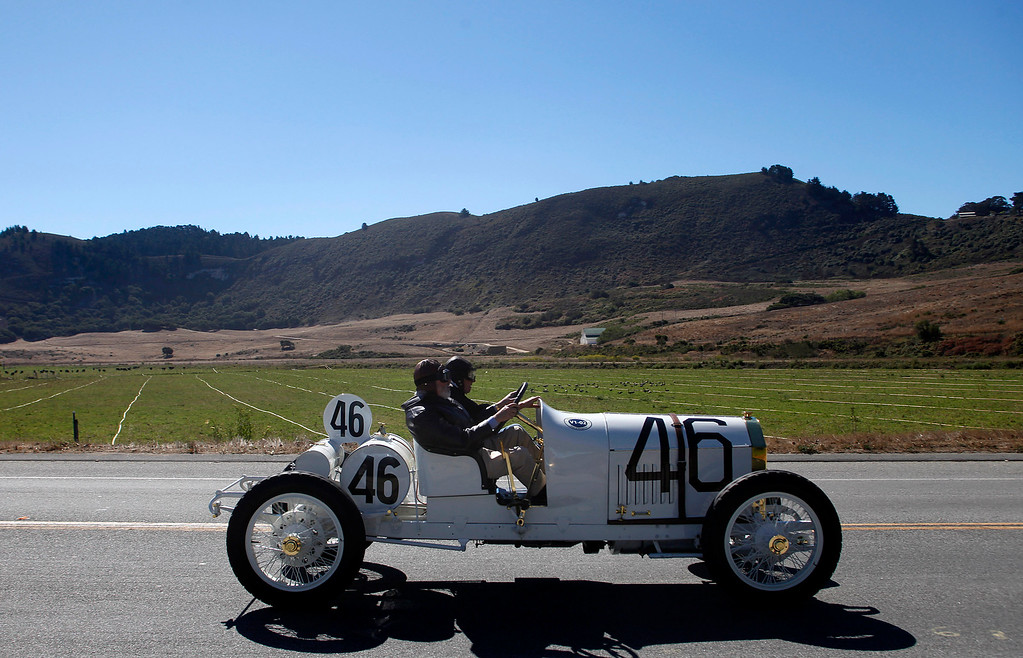 . A 1908 Benz 105 HP Prinz Heinrich Two Seat Race car owned by Bruce and Jolene McCaw drives past the old Odello Ranch on their way south toward Big Sur on Highway 1 during Pebble Beach Tour d�Elegance in Carmel, Calif. on Thursday August 15, 2013. The Route starts in Pebble Beach, passes through Laguna Seca Raceway, Carmel Valley and Big Sur before returning to the Monterey Peninsula.  (Photo David Royal/ Monterey County Herald)