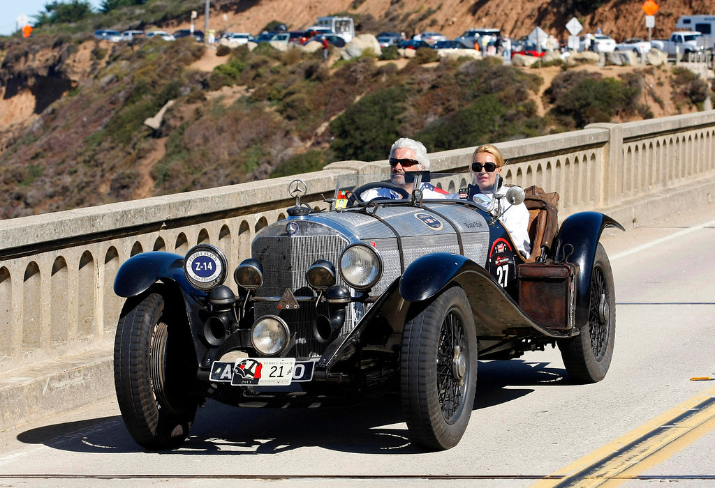 . Frans von Haren drives his 1932 Alfa Romero 8C 2300 Touring Le Mans travels south on Highway 1 over the Bixby Creek Bridge during the Tour d\'Elegance on August 15, 2013.  (Vern Fisher/Monterey County Herald)