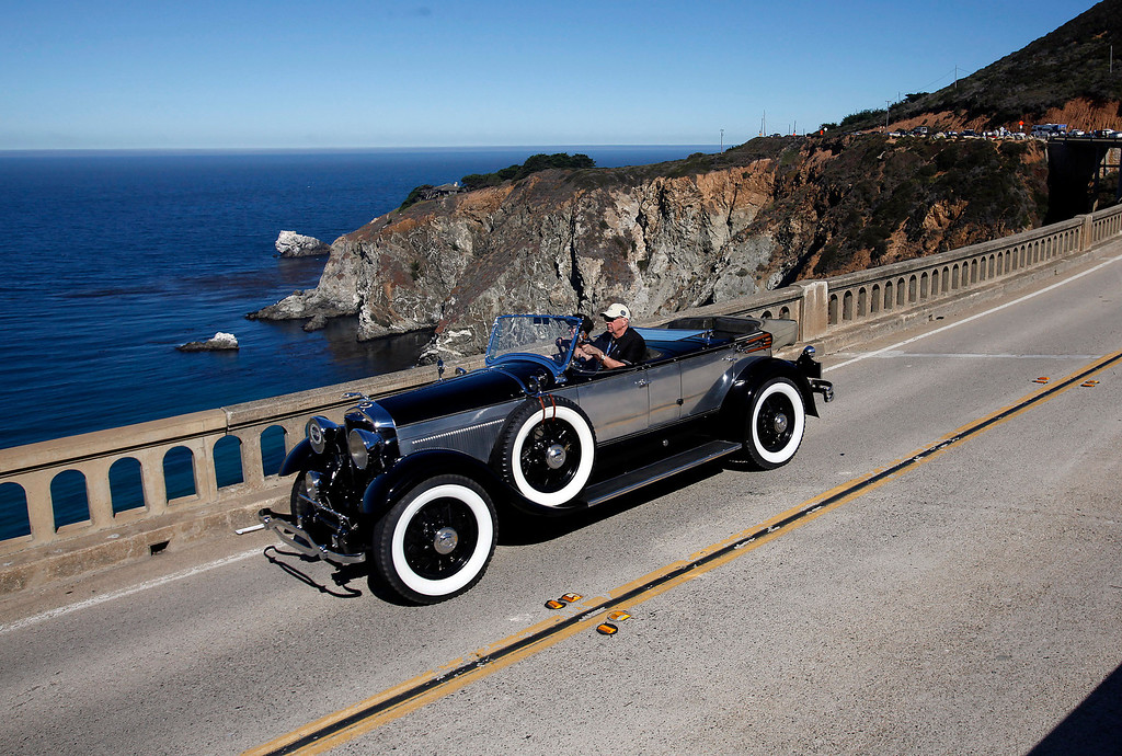 . Robert Berry in his 1921 Lincoln Locke Sport Phaeton traveling south on Highway 1 over the Bixby Creek Bridge during the Tour d\'Elegance on August 15, 2013.  (Vern Fisher/Monterey County Herald)
