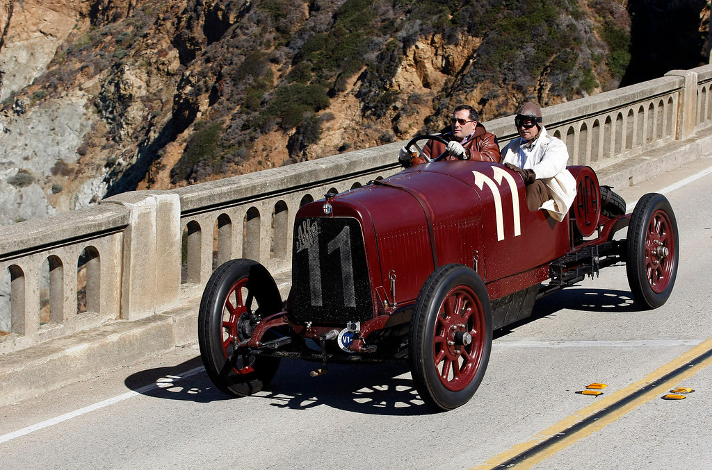 . Tony Shooshani drives his 1921 Alfa Romero G1 Race Car on Highway 1 over the Bixby Creek Bridge during the Tour d\'Elegance on August 15, 2013.  (Vern Fisher/Monterey County Herald)