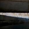 Iron Bridge road can be seen through a broken side panel
