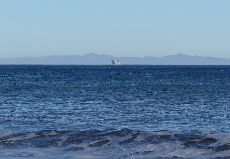 Near Gaviota, 2014. Santa Cruz Island lies behing an oil platform near Gaviota.