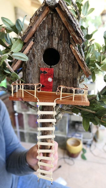 One of Ty's Fairy Houses, the Tree House, 2020.  It features a rope ladder leading to the front porch. The portch has a hand rail made with twisted copper.