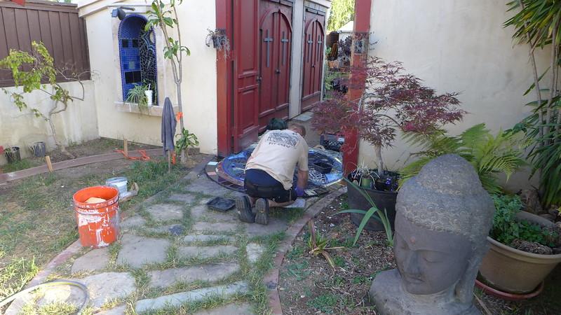 Ty working on walkway mandala.