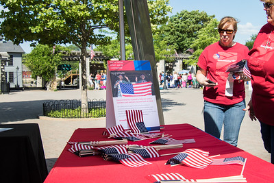 """The annual Salute to America Independence Day celebration took place at Greenfield Villlage in Dearborn June 30 - July 3, 2016. Bank of America Community Volunteers passed out American flags and """"I Support the Troops"""" stickers as people waited for the gates to open on Thursday. Photo by Debbie Malyn for the Press & Guide."""