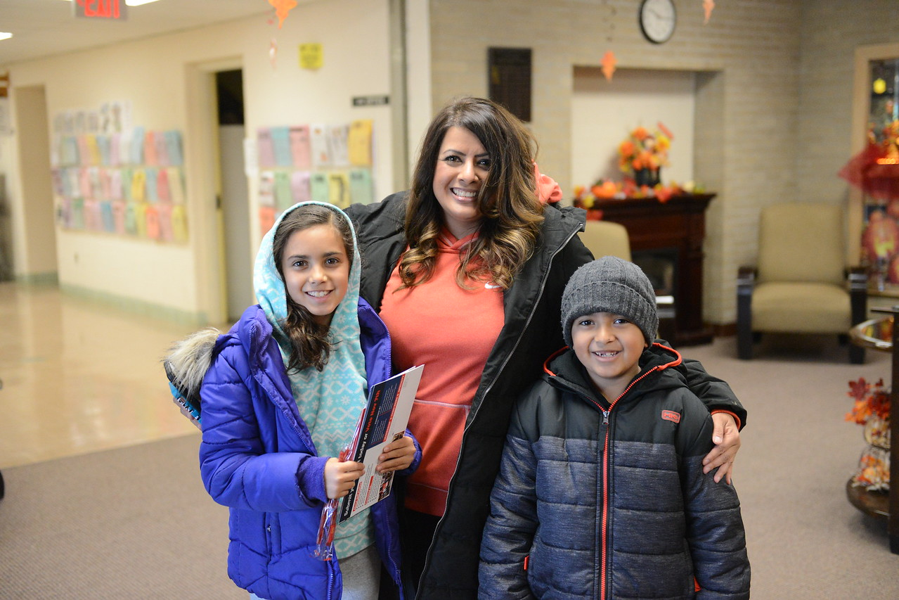 Dearborn Heights resident Rocio Mansour poses with her two children, Ava and Noah, on their way to vote at the Berwyn Senior Center in Dearborn Heights on Election Day.