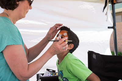 Zain Alabukahilia in the face painting booth. Photo by Debbie Malyn for the Press & Guide.