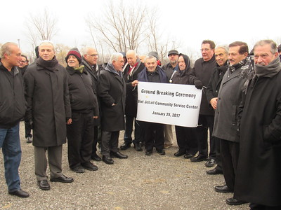 BJCC creator Mohammed Turfe, along with members of the community, pose in front of a sign announcing the groundbreaking of the organization's new community service center.