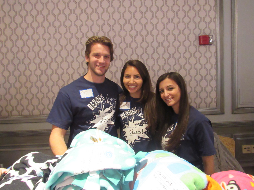 . Bryce Goulah, co-founder of organization Fleece and Thank You, poses with volunteers  Deanna Lyght and Natalia Eshou.
