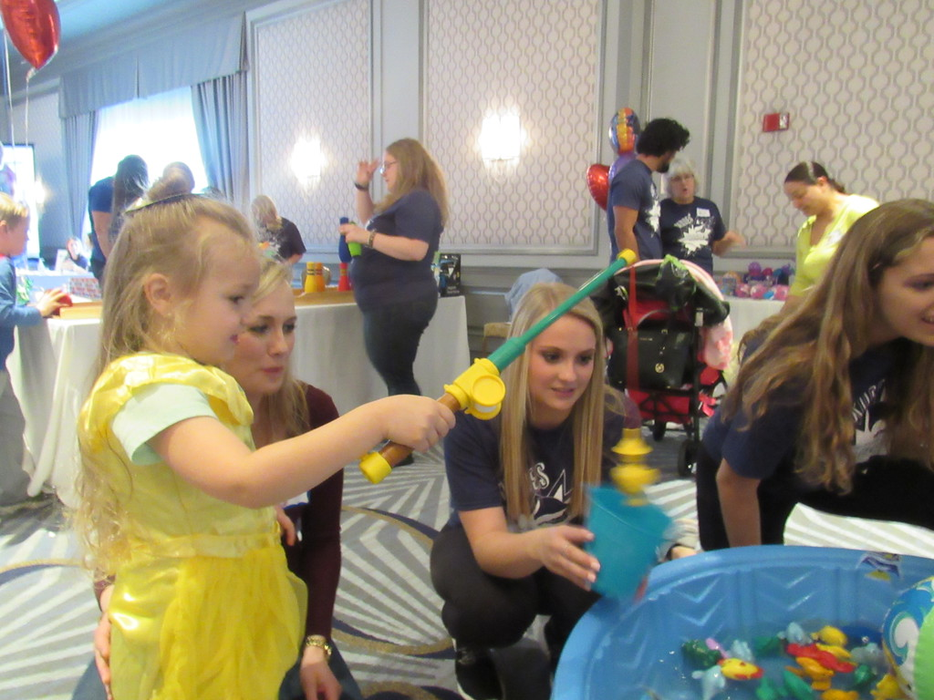 ". ""Belle\"" catches a fish at the annual event hosted by the Children\'s Hospital of Michigan."