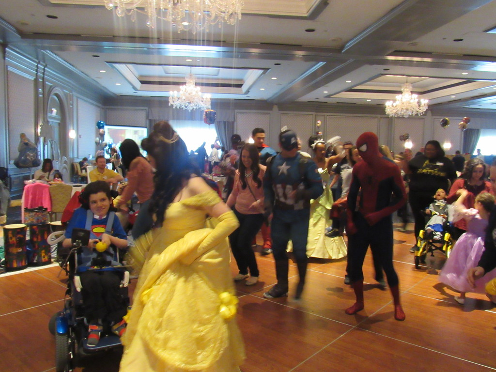 . Belle, Spider-Man, and Captain America joined the kids on the dance floor at the  8th annual Princess and Superhero Party.