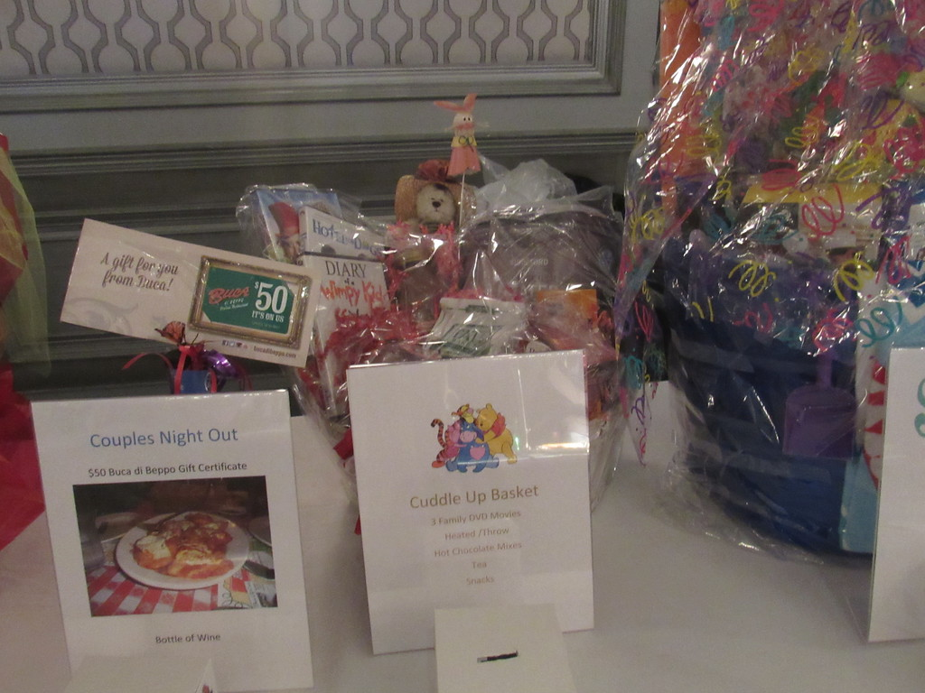 . Parents had the chance to win gift baskets as part of the raffle drawings at the party.