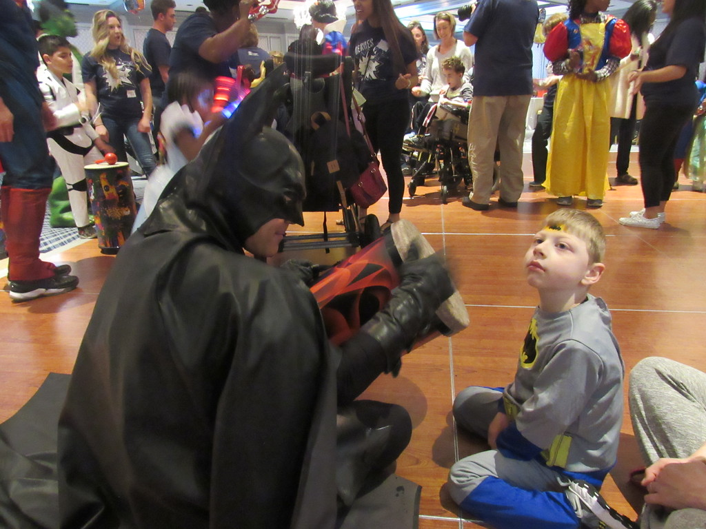 . Batman entertains a fan at the 8th annual Princess and Superhero Party Sunday, May 7.