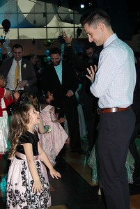 Cameron Keyes (left), 4, and Justin Keyes enjoy the Daddy – Daughter Dance Feb. 3 in the Hubbard Ballroom at the Ford Community and Performing Arts Center.