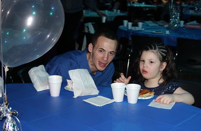 Nicholas Phillips (left) and Gloria Rodriguez, 4, spend some quality time together at the soiree.