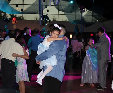 Dads and daughters enjoy the last slow dance Feb. 3 at the Daddy – Daughter Dance in the Hubbard Ballroom at the Ford Community and Performing Arts Center.