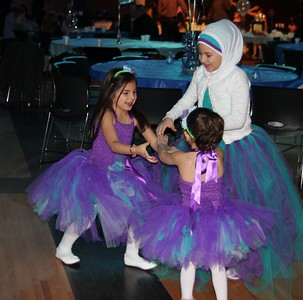 Elaina Mohaidly (left), 5, her cousin Dena Wazne, 2, and her sister Liana Mohaidly, 9, take a spin around the dance floor together.