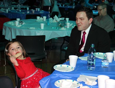 "Ava Fugedi (left), 3, and her father Nick enjoy refreshments at the ""Under the Sea"" themed Daddy Daughter Dance in Dearborn on Feb. 3."