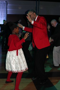 Peyton Palmer (left), 10, of Dearborn and Kenneth Snodgrass enjoy the Daddy – Daughter Dance Feb. 3 in the Hubbard Ballroom at the Ford Community and Performing Arts Center.