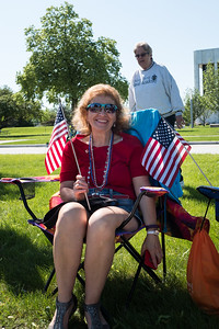 Maryann Aiton, Livonia resident and member of the Dearborn Maltese Club, awaits the start of the parade. Photo by Debbie Malyn for the Press & Guide.