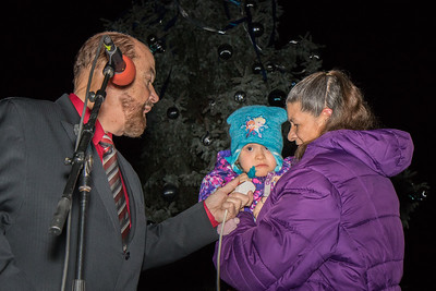Cheyenne Weaver, a student at Nowlin Elementary, assisted Mayor John B. O'Reilly, Jr. in lighting the tree. Photo by Debbie Malyn for the Press & Guide.