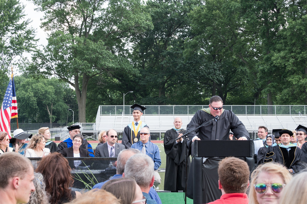 . Principal Scott Casebolt introduces Salutatorian Abraham Alawy. Photo by Debbie Malyn for the Press & Guide.