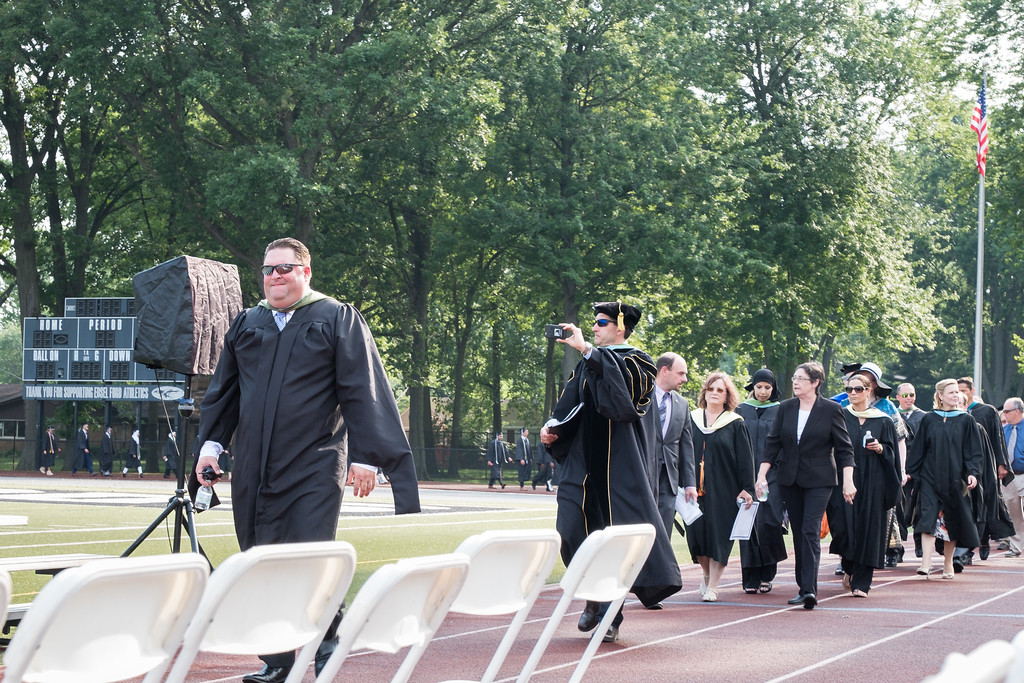 . Edsel Ford Principal Scott Casebolt and Dearborn Public Schools Superintendent Dr. Glenn Maleyko lead the graduates to the risers. Photo by Debbie Malyn for the Press & Guide.