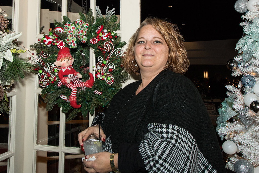 . Elizabeth McCauley with the elf wreath she designed. Photo by Debbie Malyn for the Press & Guide.