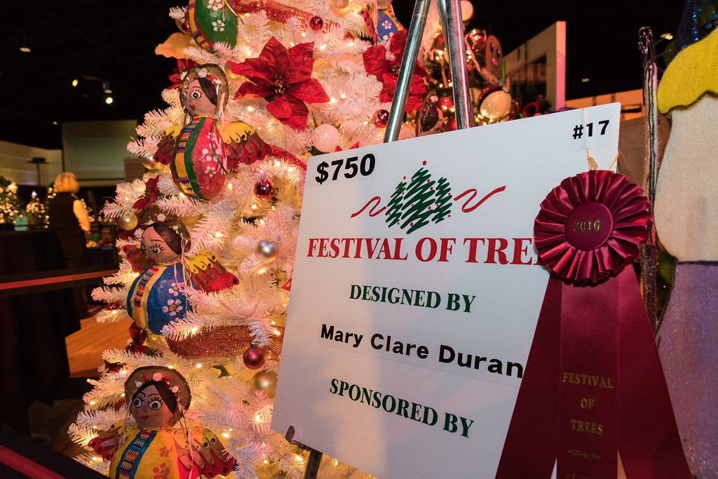 . Mary Clare Duran created hand made paper mache angels for her tree. Photo by Debbie Malyn for the Press & Guide.