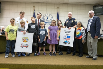 Students from Dearborn Heights' District 7, which includes Bedford, Polk and Pardee Elementary Schools, as well as O.W. Best Middle School and Annapolis High School made cards they presented to first responders at Tuesday night's City Counsel Meeting.  Photos by Matt Thompson, Copyright 2016 Press & Guide