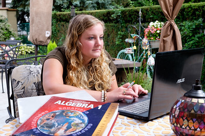 Kaitlin Macari, a first year Algebra Teacher at Crestwood High School, prepares lesson plans on the patio of her Dearborn Heights home several weeks before the beginning of the school year. Photos Copyright 2016 Matt Thompson for The Press & Guide.