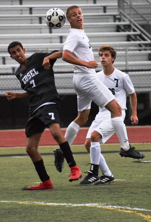 . Allen Park\'s Benjamin Church (right) goes up for the ball against Edsel Ford\'s Moath Ali during a 1-1 tie on Wednesday night at Edsel Ford. Also pictured is Allen Park\'s Trevor Watters (7). Alex Muller - For Digital First Media