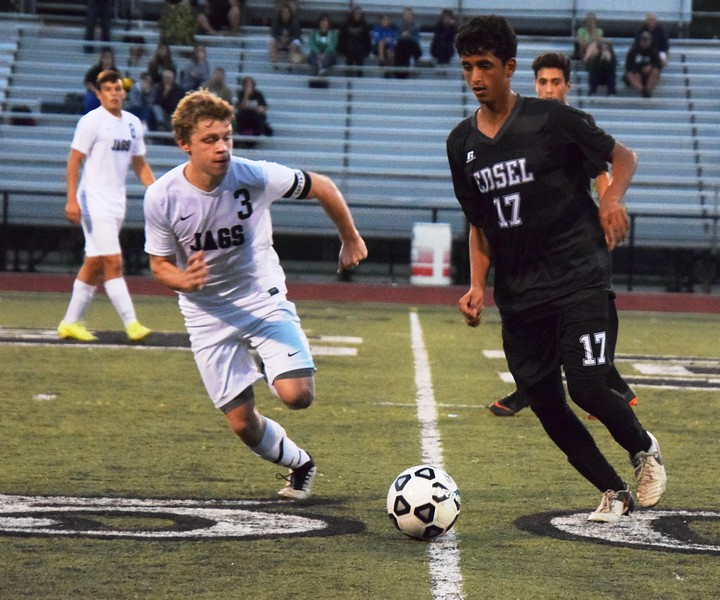 Hussein Mohsen of host Edsel Ford (17) is defended by Allen Park's Johnathan Klein during the teams' 1-1 tie on Wednesday night at Edsel Ford. Alex Muller - For Digital First Media