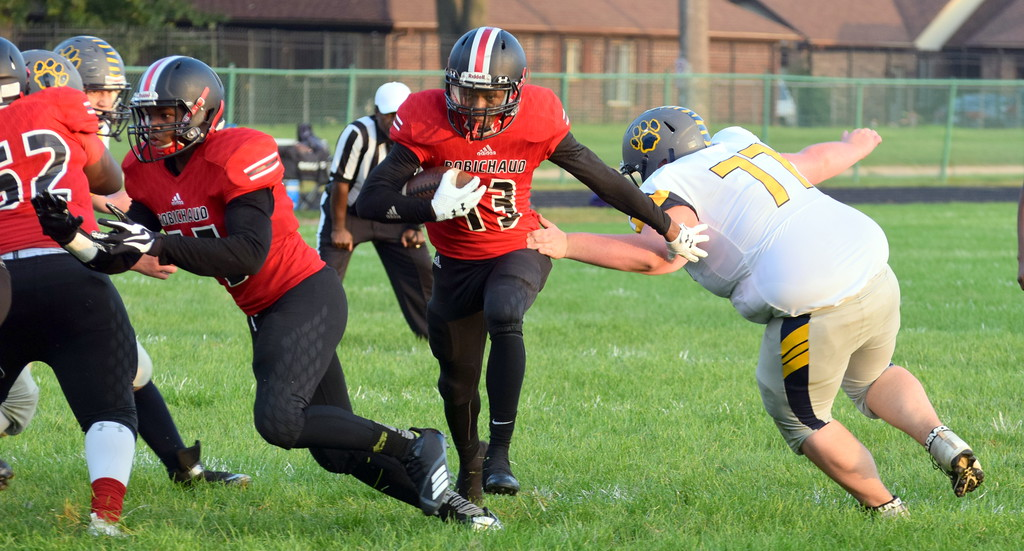 . Robichaud\'s Tamondre Jackson (13) heads for the end zone during his team\'s battle with visiting Annapolis on Friday night. Jackson and the Bulldogs ultimately earned a 54-8 victory over the Cougars. Frank Wladyslawski - Digital First Media - Frank Wladyslawski