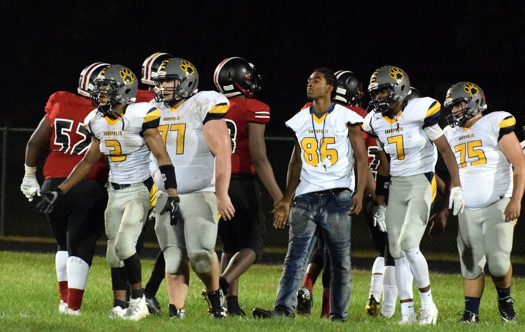 . Robichaud welcomed in Annapolis on Friday night for a WWAC battle that featured two schools both located in Dearborn Heights.  The powerful Bulldogs ultimately rolled to a 54-8 win over the Cougars. Frank Wladyslawski - Digital First Media - Frank Wladyslawski
