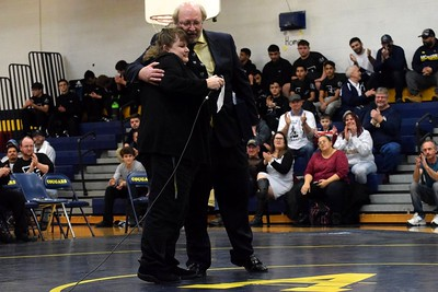 Annapolis coach Vic McGuire was honored on Wednesday night in what was the Cougars' final home quad meet of 2017-18. McGuire is retiring after the season. In wrestling action, Annapolis defeated Redford Thurston and fell to Edsel Ford, while Belleville defeated Edsel and Thurston. Photo by Frank Wladyslawski - Press & Guide