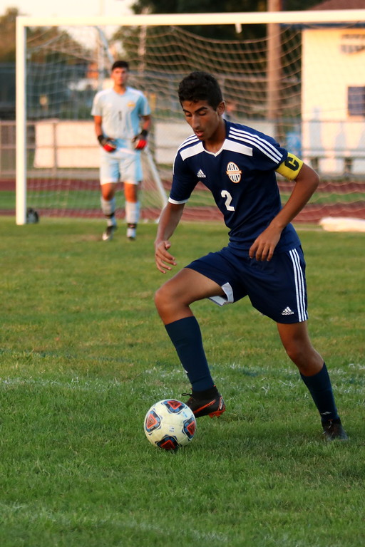 . Crestwood\'s Mohamed El-Habhab plays the ball during his team\'s battle with visiting Livonia Clarenceville on Monday night. The Chargers came away with a 2-1 victory over the Trojans. Ryan Dickey - For Digital First Media