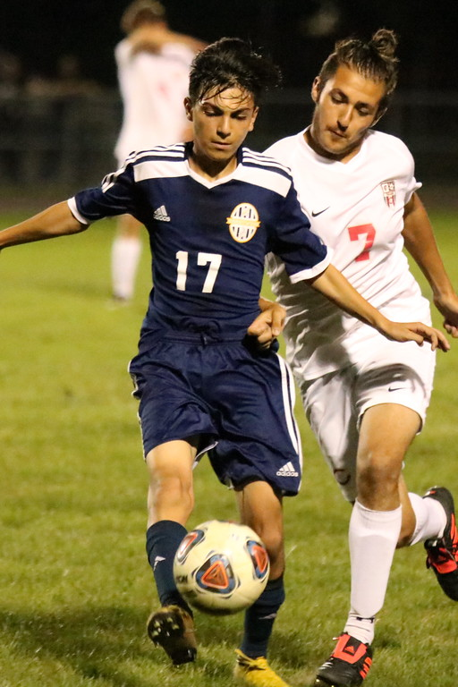 . Crestwood\'s Mohamed Hammoud (17) battles with Jon Sanchez of Livonia Clarenceville on Monday night. Hammoud and the host Chargers held on for a 2-1 victory. Ryan Dickey - For Digital First Media