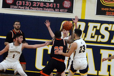 Dearborn High traveled to Crestwood on Thursday night and knocked off the Chargers by a score of 74-64. Photo by Von Lozon - For the Press & Guide